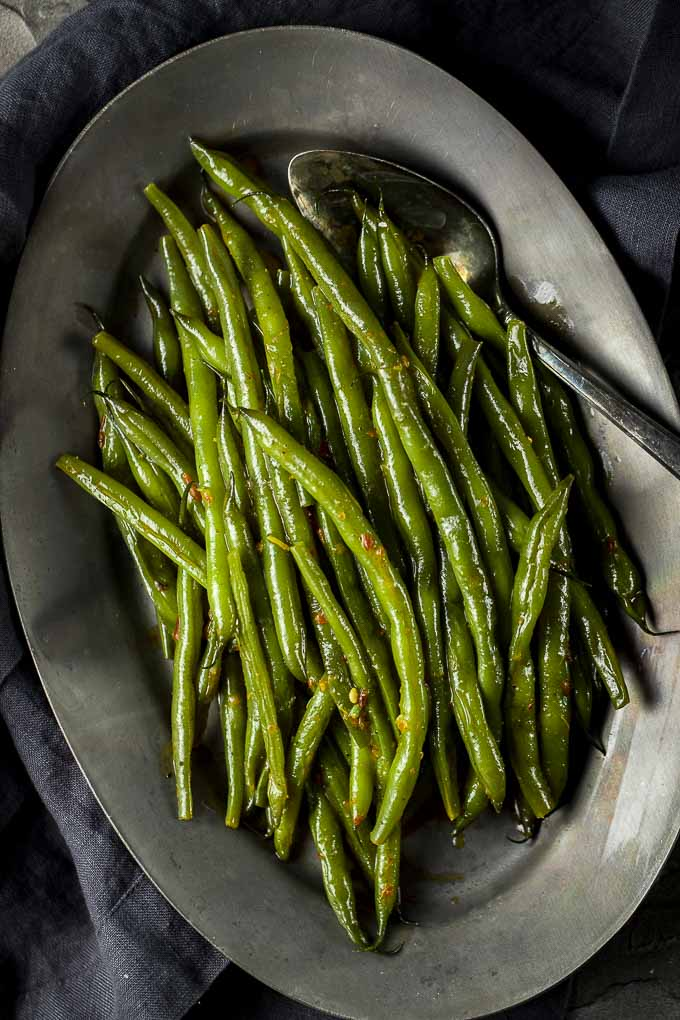green beans with creamy chili sauce on a plate