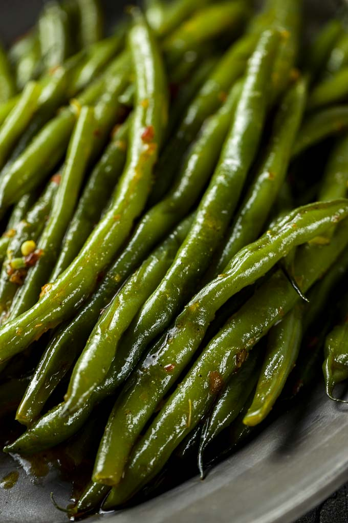 green beans with flecks of chili