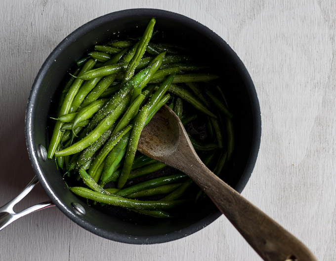 green beans and garlic in a saucepan