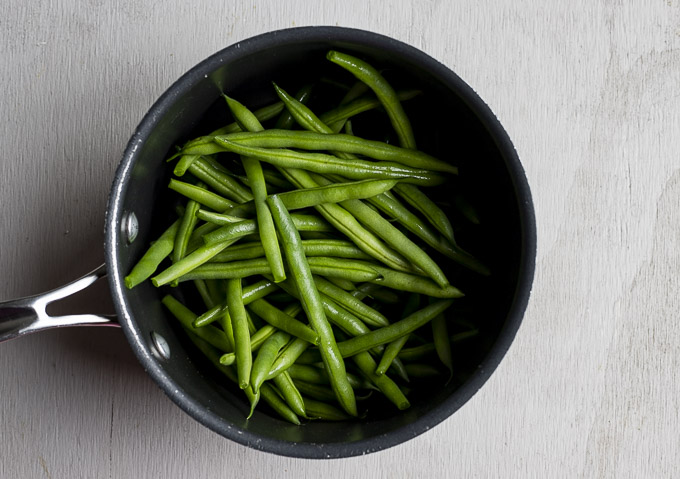 raw green beans in a saucepan