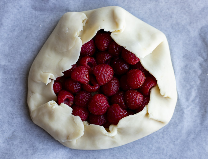 pie crust wrappe around a pile of raspberries