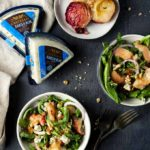 2 bowls of salad with grilled peaches and blue cheese