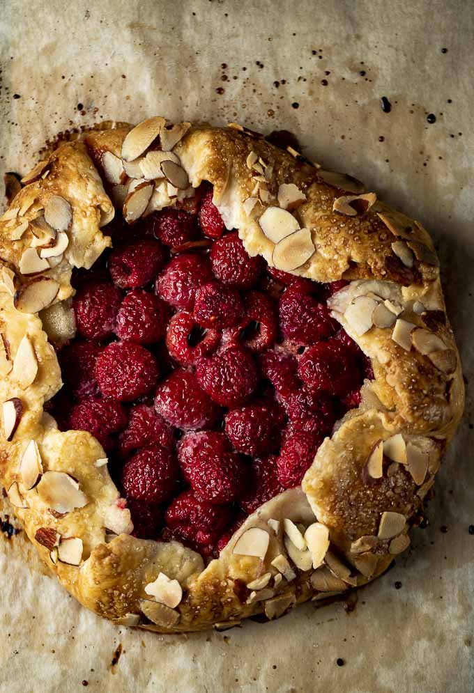 raspberry galette with almonds on the crust