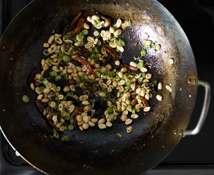 peanuts and chilies in a wok