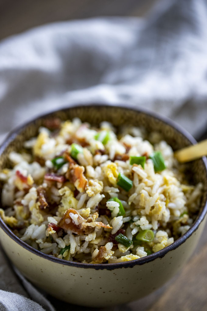 fried rice with bacon and eggs in a bowl