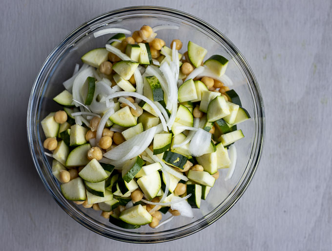 bowl of chopped zucchini, chickpeas and onions