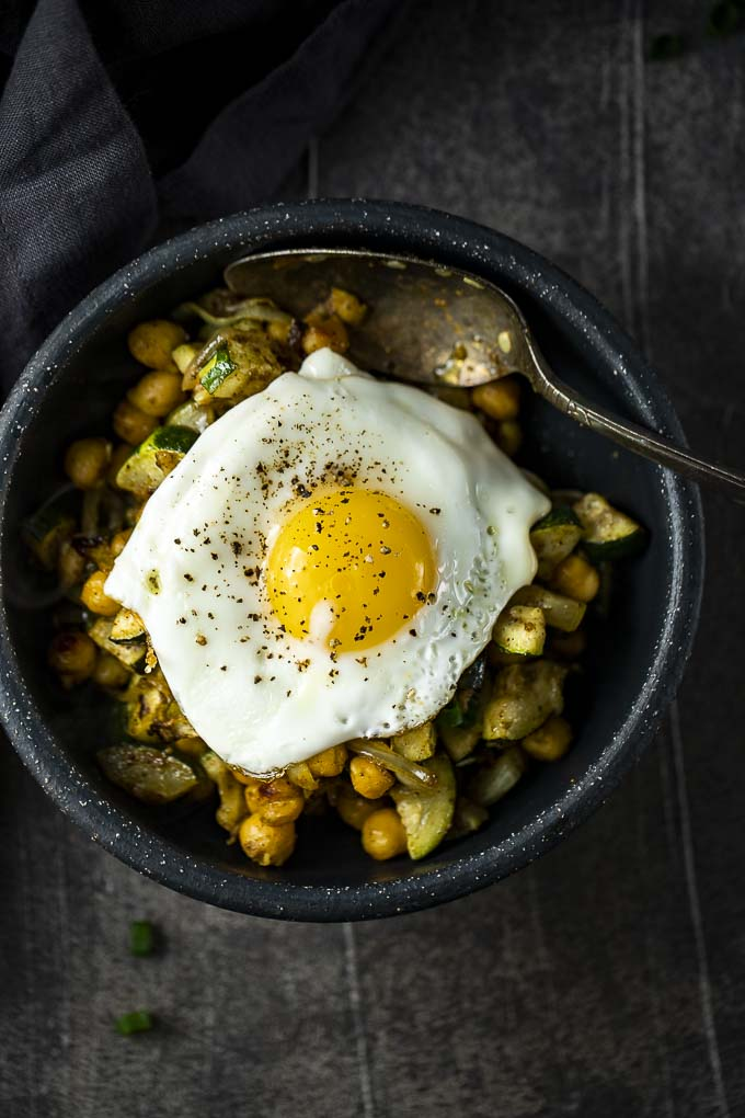 chickpea and zucchini salad with an egg on top