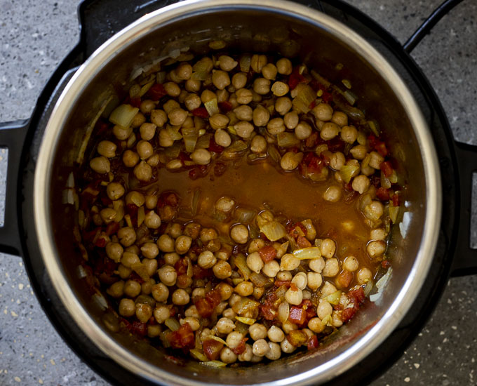 chickpeas and tomatoes in broth in a pot