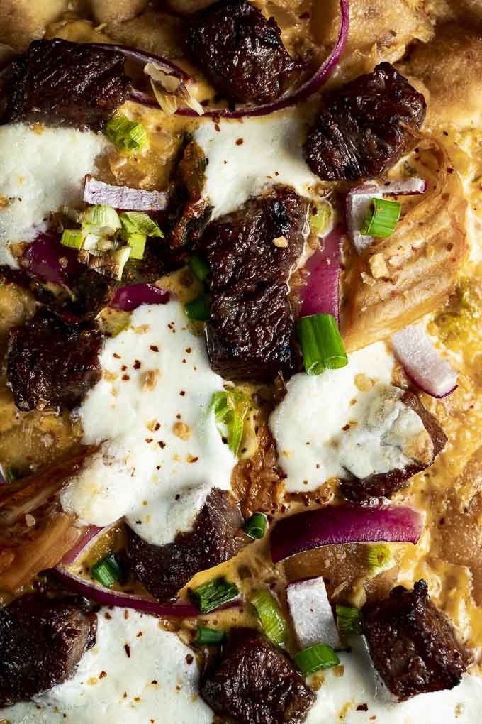 beef, cheese and onions on crust - close up
