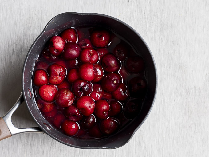 whole red cherries in saucepan