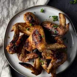 plate of crispy cajun chicken wings