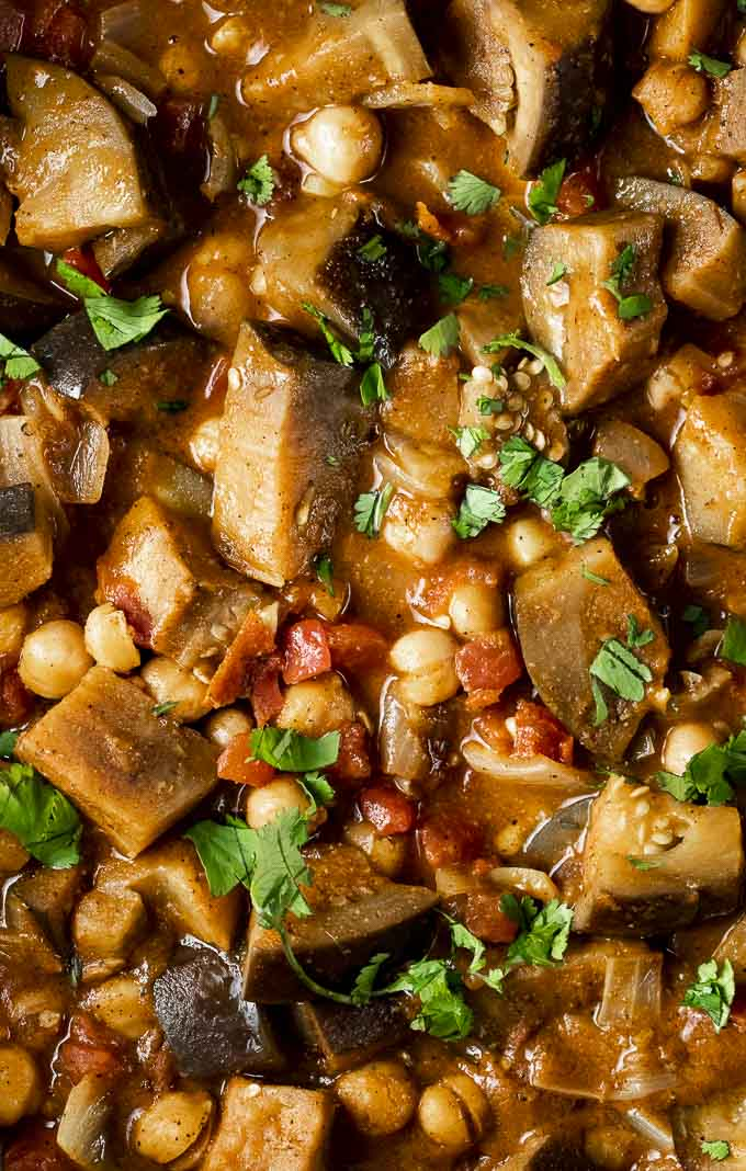 eggplant and chickpeas with vegetables in orange curry sauce