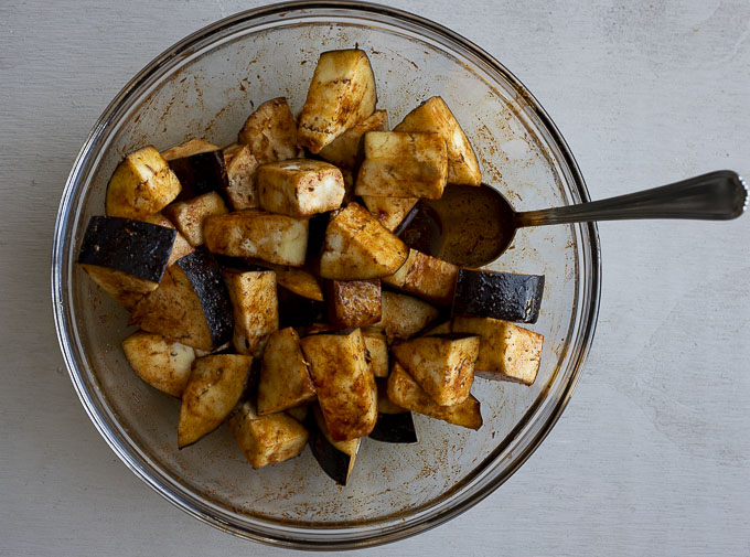 bowl of eggplant in an orange sauce