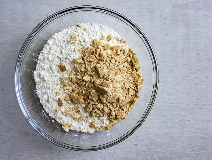 flour and crushed graham crackers in a bowl