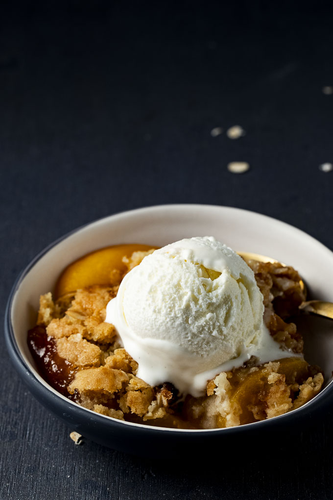 ice cream over cobbler in a bowl