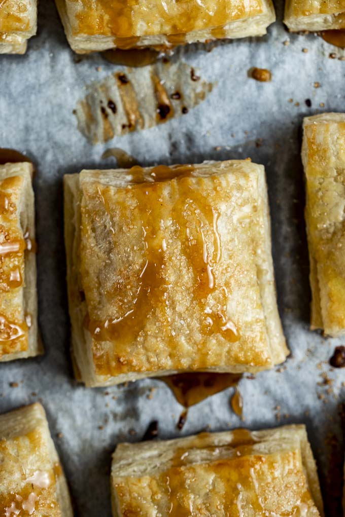pastry drizzled in caramel on parchment paper