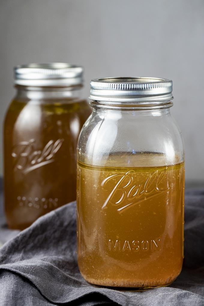 2 jars of gold liquid