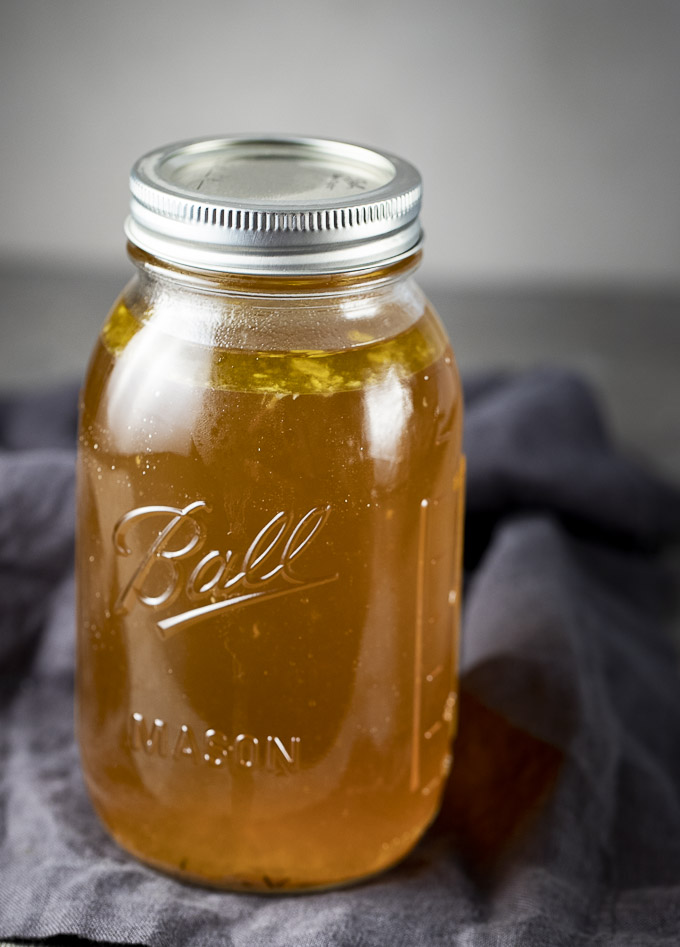glass jar filled with broth