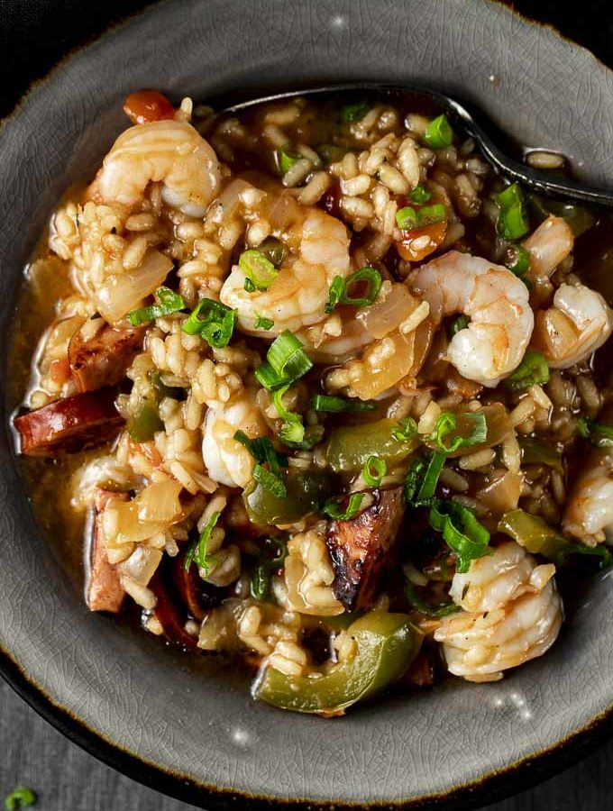 bowl of rice with shrimp, vegetables and sausage
