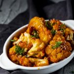dish of spicy roasted cauliflower with green onions