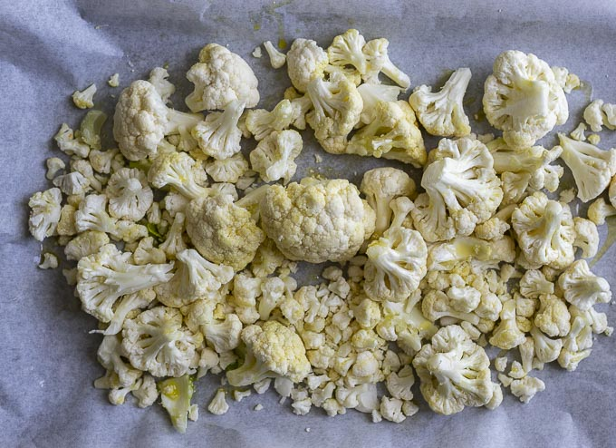 raw cauliflower on a baking sheet
