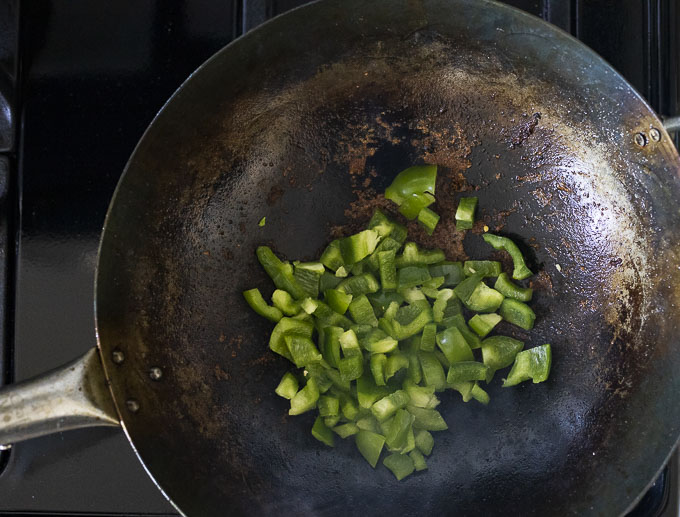 green peppers on a wok