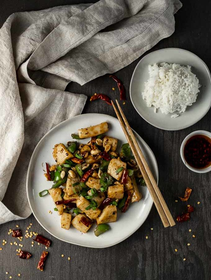 kung pao calamari on a plate with bowl of rice on the side