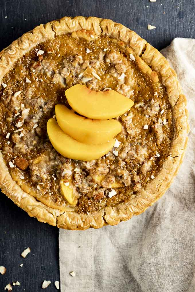 baked almond tart with sliced peaches on top