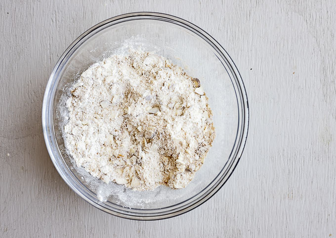 flour and crushed almonds in a glass bowl