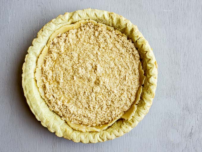 beige batter in a pie crust (unbaked)