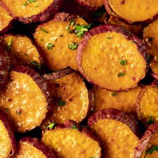 sweet potato slices in glaze garnished with parsley