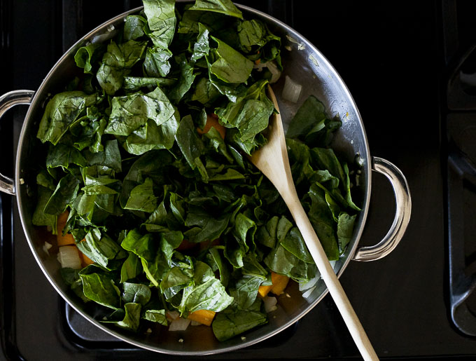 pieces of fresh spinach in a skillet