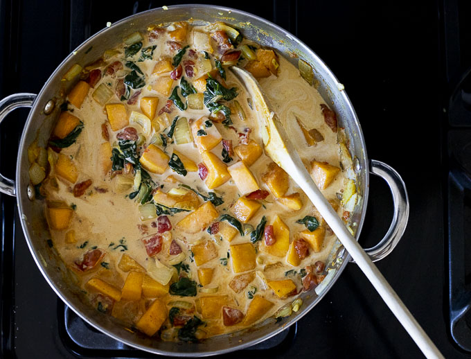 vegetables in a creamy orange sauce in a skillet