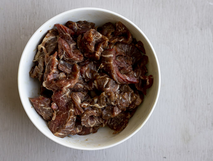 raw slices of beef in a bowl