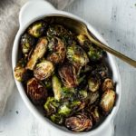 dish of glazed brussels sprouts with a spoon