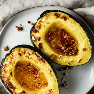 2 acorn squash halves sprinkled with pecans