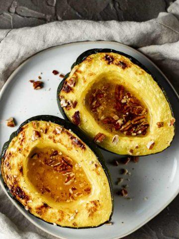2 acorn squash halves sprinkled with pecans
