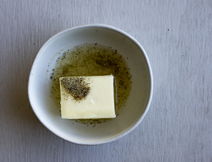 butter and pepper in a bowl