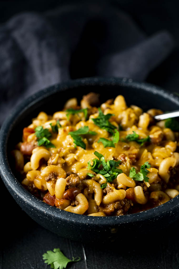 chili macaroni on a bowl with a spoon
