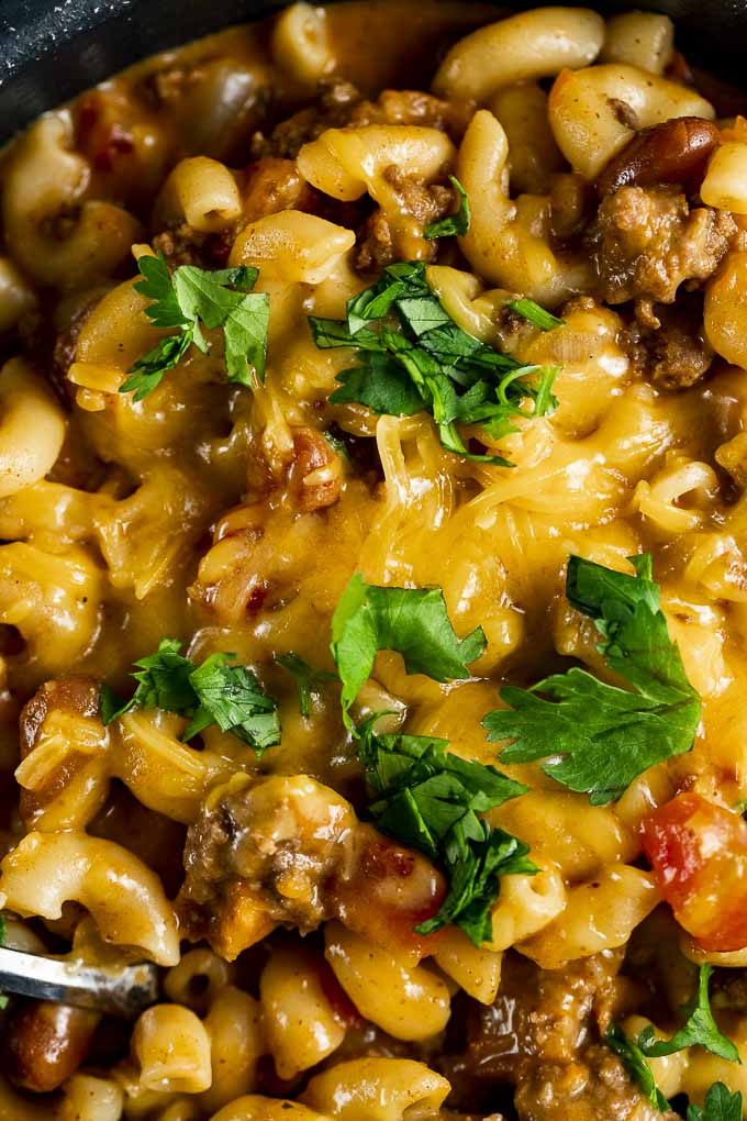 cheese covered macaroni in a red meat sauce