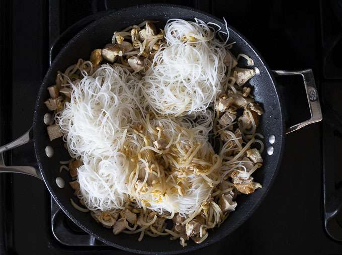 chopped chicken and rice noodles in a skillet