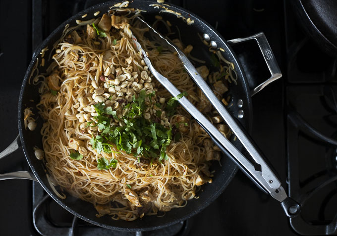 rice noodles with sauce, chicken, peanut and topped with cilantro