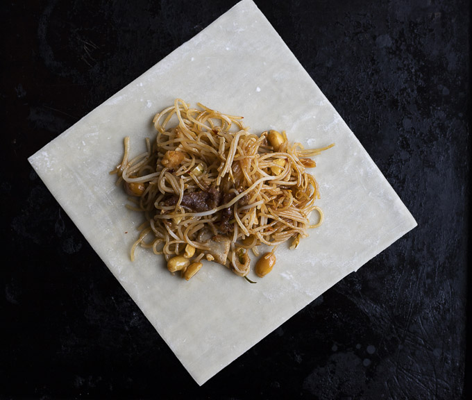 pad thai noodles on an egg roll wrapper