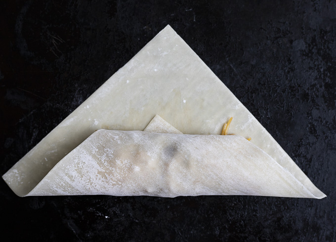 rolling an egg roll wrapper