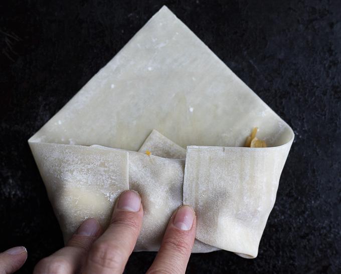 folding up an egg rolls wrapper
