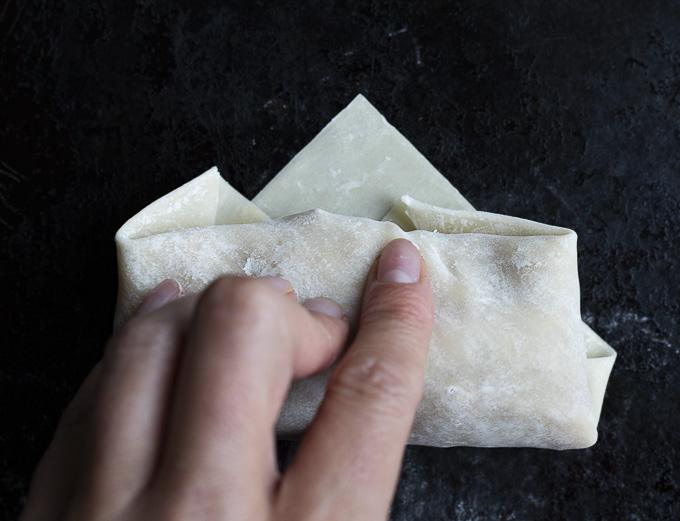 rolling an egg roll with hands