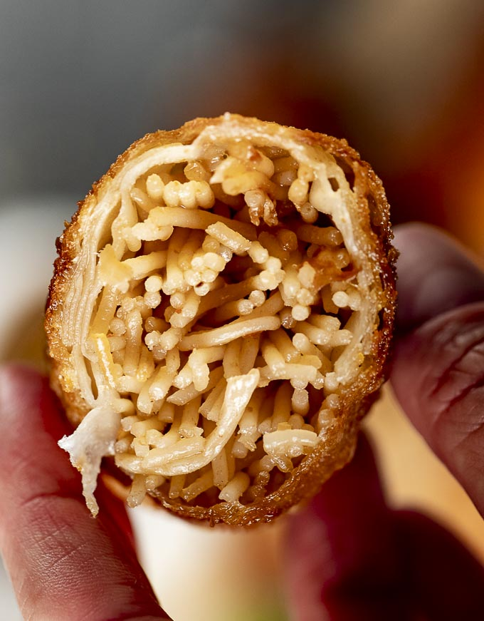 fried egg roll wrapper filled with rice noodles