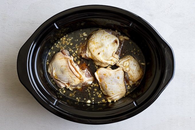 chicken thighs in a crockpot with brown sauce