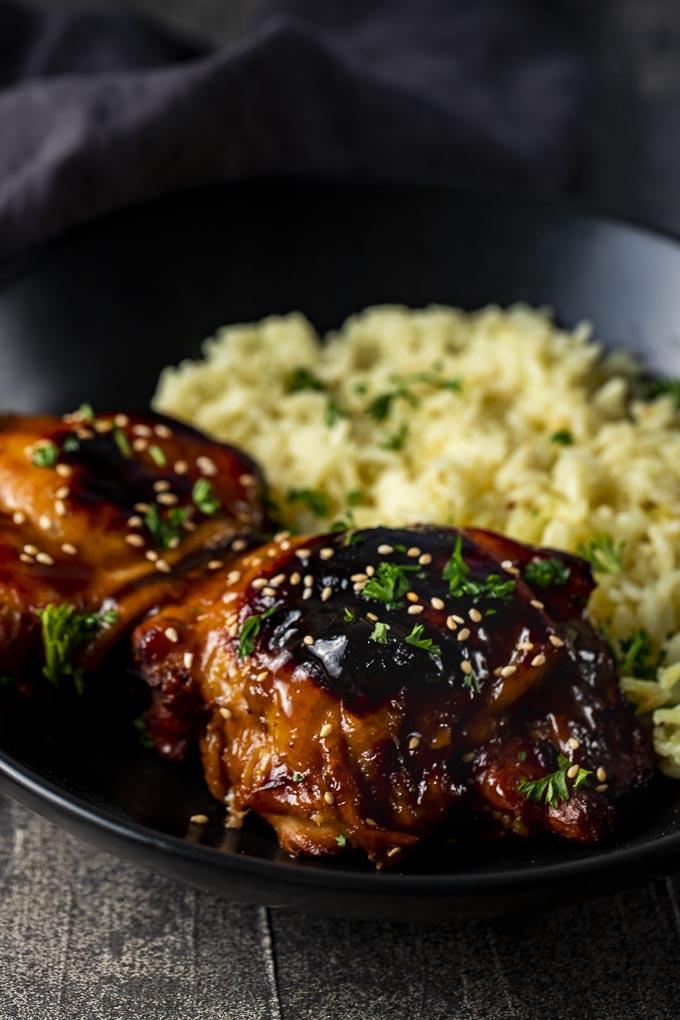 crispy chicken thighs garnished with sesame seeds