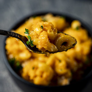 spoonful of orange colored mac and cheese